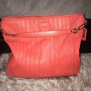 Gently used Coral leather coach handbag